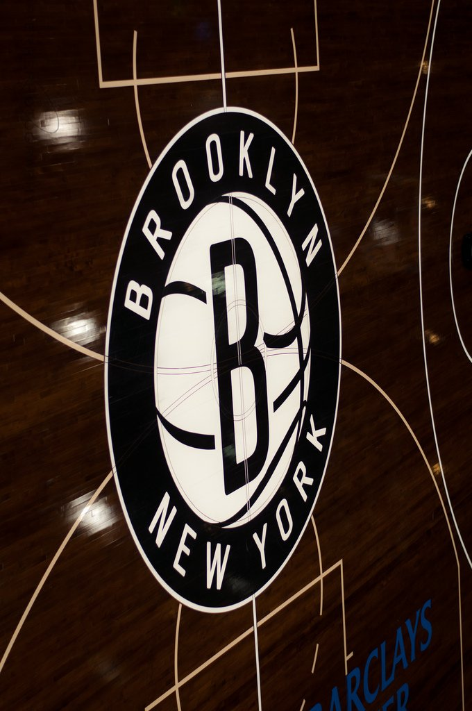 "Maxim Pierre (https://commons.wikimedia.org/wiki/File:Brooklyn_Nets_floor_graphics.jpg), ""Brooklyn Nets floor graphics"", https://creativecommons.org/licenses/by/2.0/legalcode"